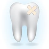 White tooth on blue background Stock Photos