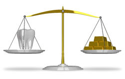 White tooth and gold on scales Stock Photo