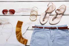 White top with blue shorts and bracelets. stock photography