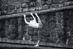 White topless man stretching at stony wall Stock Photography