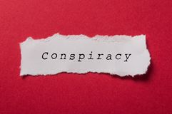 White torn paper on red paper background - Conspiracy. Closeup of white torn paper on red paper background - Conspiracy royalty free stock images