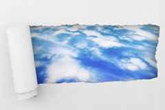 White Torn paper with sky Royalty Free Stock Photography