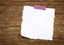 White torn paper on wood Stock Images