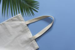 White tote bag canvas fabric. Cloth shopping sack mockup with copy space.  stock photography