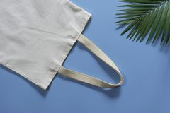 White tote bag canvas fabric. Cloth shopping sack mockup with copy space.  stock images