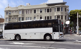 White Tour Charter Bus. Side view of white tour charter bus on San Francisco city street Stock Images