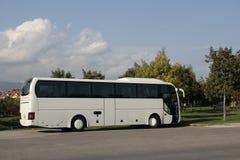 White tourist bus 2. White bus parked in the city Royalty Free Stock Photos