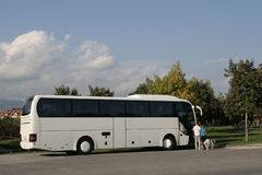White tourist bus. White bus parked in the city Royalty Free Stock Photography