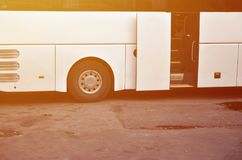 White tourist bus for excursions. The bus is parked in a parking lot near the park.  stock photos