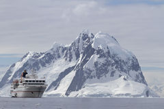 White tourist ship a summer day on a background of mountains of. The Antarctic Peninsula Royalty Free Stock Image