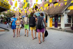 White tourists have just arrived in the city Krabi and are walking along the street in search of a hotelfor recreation. CRABI/ Thailand-January 3,2016: White stock photos
