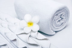 White  towel. And yellow white tropical flower Stock Images