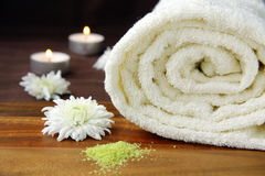 White towel. With chamomile flowers on the table royalty free stock image