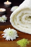 White towel. With chamomile flowers on the table Stock Image