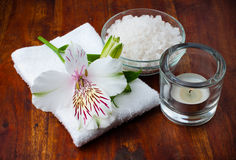 White towel, aromatic salt and flower Royalty Free Stock Photos