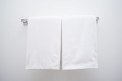 White towel in bathroom Stock Images