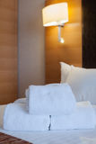 White towel on bed decoration in bedroom interior.Towel in Hotel Room , Welcome guests , Room service Stock Image