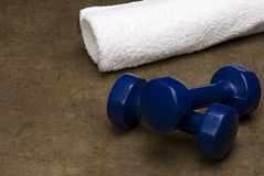 White Towel and Blue dumbbells Royalty Free Stock Photography