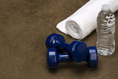 White Towel Blue dumbbells with a bottle of water  Stock Photo