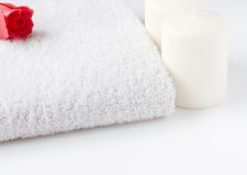 White towel with candles and rose Royalty Free Stock Photo