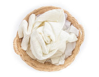 White towel and cloth in the wicker baskets on white background Stock Photos