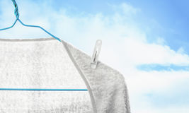 White towel on clothes hanger Royalty Free Stock Images