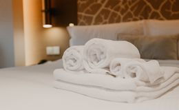 White towel decoration on bed in bed room interior stock photo