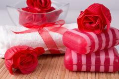 Towel and decorative soaps. White towel and decorative soaps Royalty Free Stock Images