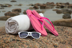 White towel, flip flops and sunglasses Stock Photo