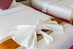 White Towel folded in bow shape on bed Royalty Free Stock Photography