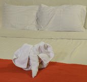 White towel in form of elephant on bed Stock Photos