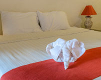 White towel in form of elephant on bed Royalty Free Stock Photos