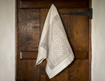 White Towel with Gray Bird's Eye Pattern Hanging on  Door Stock Photography