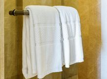 White towel on a hanger prepared to use in bathroom Stock Photo