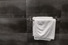 White towel on a hanger prepared to use in bathroom. Royalty Free Stock Photos