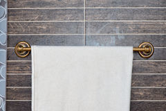 White towel on a hanger. On the wall Stock Image