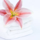 White towel and lily flower Royalty Free Stock Image