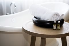 White towel and massage bath oil on table in bathroom. Abstract SPA photo.  royalty free stock photo