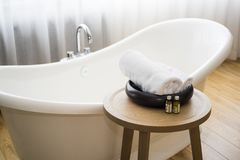 White towel and massage bath oil on table in bathroom. Abstract SPA photo.  royalty free stock photos
