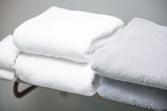 White towel placed on shelves in bathroom of hotel. Fabric Royalty Free Stock Photos