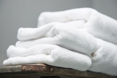White towel placed on shelves in bathroom of hotel Royalty Free Stock Photography