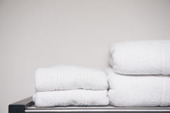 White towel placed on shelves in bathroom of hotel Stock Photo