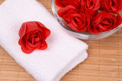 Soap and towel. White towel and a red soap rose Royalty Free Stock Photography