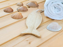 White towel, seashells and fish shaped wisp Royalty Free Stock Images