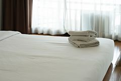 White towel set and bed in modern hotel Stock Photography