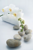 White towel and stones with orchid Stock Photos