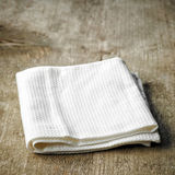 White towel on wooden table Stock Photo