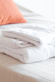 White towels on the bed. White towels lying on the bed stock photos