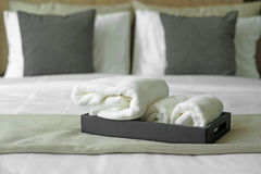White towels on bed Stock Images