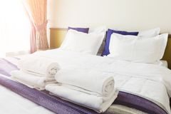 White towels on bed in hotel bedroom Royalty Free Stock Images